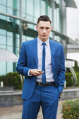 Portrait of a young businessman with cellphone — Stock Photo