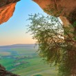 Cave in mountain on sunrise — Stock Photo