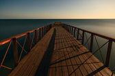 Pier at sunset in the sea. Black sea, Crimea, Ukraine — Stock Photo