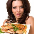 Young woman posing with a meal — Stock Photo