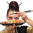 Young woman with sushi — Stock Photo
