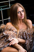 Attractive young woman wearing a fur — Stock Photo