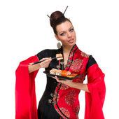 Woman in traditional dress with sushi — Stock Photo
