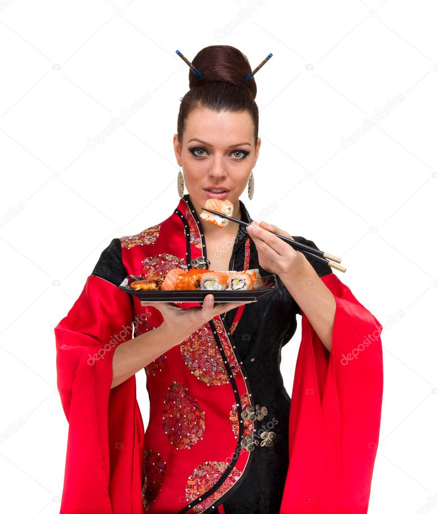 Attractive woman in traditional dress with sushi, isolated on white background. — Stock Photo #13379478