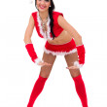 Young woman wearing santa claus clothes posing — Stock Photo