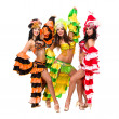 Stock Photo: Three young sexy carnival dancers posing