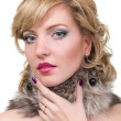 Beautiful woman with fur — Stock Photo