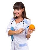 улыбаясь доктор с оранжевым — Стоковое фото