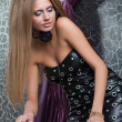 Beautiful and sexy DJ girl on decks — Stock Photo