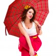 Young woman with a red umbrella — Stock Photo