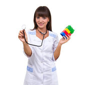 Young medic pediatrician with toys — Stock Photo