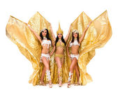 Three belly dancers with golden wings — Stock Photo