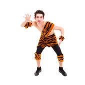 Wild man wearing a tiger skin — Stock Photo
