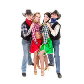 Smiling cowboys and cowgirls — Stock Photo