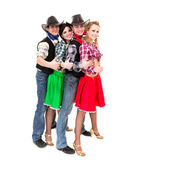 Smiling cowboys and cowgirls with thumbs up gesture — Stock Photo