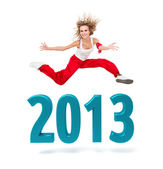 Woman jumping over a 2013 New Year sign — Stock Photo