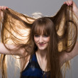 Woman shows her beautiful hair in backlight — Stock Photo