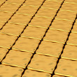 Stock Photo: Gold deformed cubes background