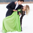 Young couple on the snow — Stock Photo #16813343