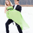 Young couple on the snow — Stock Photo #16813345