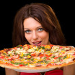 Royalty-Free Stock Photo: Young woman eating pizza