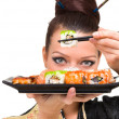 Close up portrait of young woman with sushi — Stock Photo