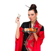 Woman in traditional red dress with sushi — Stock Photo