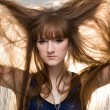 Woman shows her beautiful hair — Stock Photo #18473441