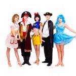 Dancers in carnival costumes posing — Stock Photo