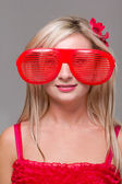 Woman in crazy clown glasses — Stock Photo