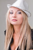 Elegant sexy woman with hat — Stock Photo