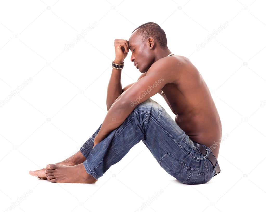 Stressed African Man Sitting With Hand On Head
