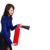 Young businesswoman using a fire extinguisher — Stock Photo