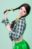 Funny cute smiling woman with pigtails on green — Stock Photo