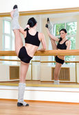 Sporty girl doing physical exercise — Stock Photo