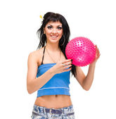 Young woman holding small fitness ball — Stock Photo