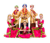 Dancers dressed in Indian costumes posing — Stock Photo