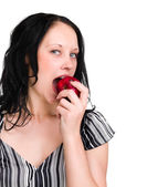 Woman holding an apple she's about to eat — Stock Photo