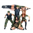 Military dancer team dressed in camouflage costumes — Stock Photo