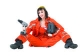 Young builder woman with a drill — Stock Photo