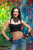 Girl standing in front of art graffiti — Stock Photo