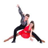 Elegante junge Paar Tanzen auf weißem Hintergrund — Stockfoto