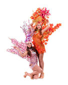Two carnival dancer women dancing against isolated white — Stock Photo