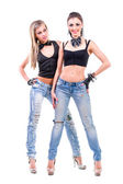 Two young sexy women in denim jeans isolated on white — Stock Photo