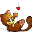 Cute cat playing with heart decoration — Stock Vector #18559379
