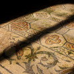 Roman mosaic in old church illuminated by church window — Stock Photo #13379098