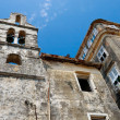 Stock Photo: Decayed old church and houses, Corfu City Greece