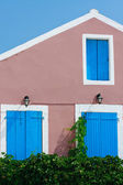 Traditional Greek village house with blue windows and doors — Stock Photo