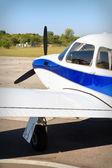 Propeller air plane on runway — Stock Photo