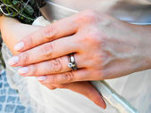 Bride wearing her diamond and wedding rings — Stock Photo